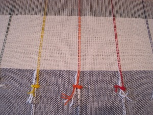 transition of decorative threads, anchored with pins